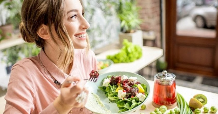 young woman enjoying vegetarian keeto diet